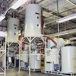 Two CDD-600 Desiccant Dryers with two CDH-2500 Drying Hoppers on stand