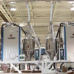 Two HCD-100 Honeycomb Dryers and four CDH-75 Hot Air Dryers mounted on stands
